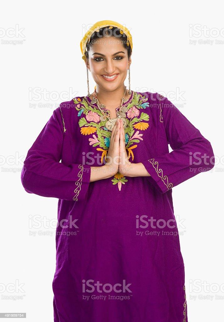 Woman in traditional Kashmiri dress greeting stock photo