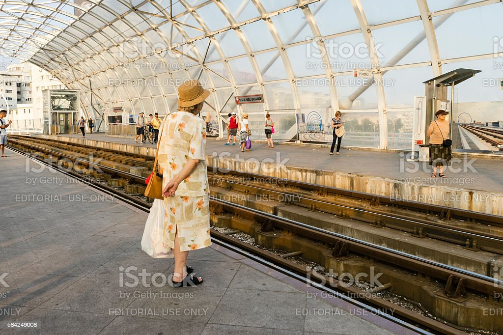 Woman in tram station stock photo
