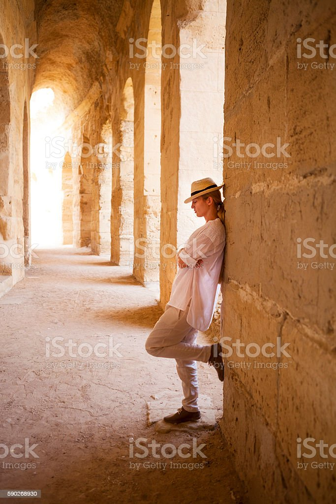 Woman in Tunisia El Jem roman apmphitheatre stock photo