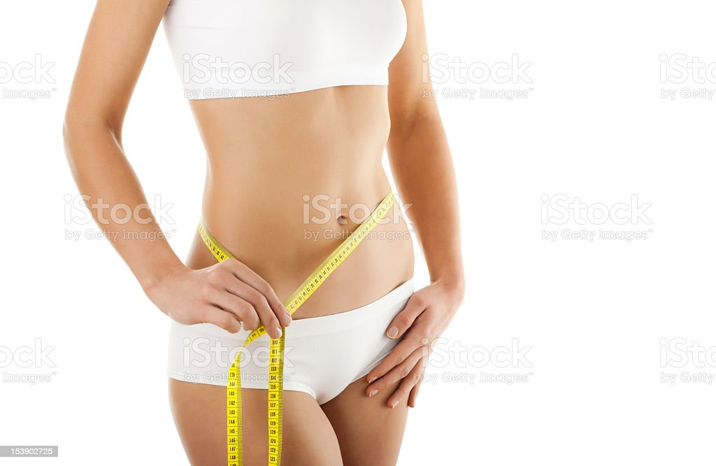 Woman in underwear with yellow measuring tape around waist royalty-free stock photo