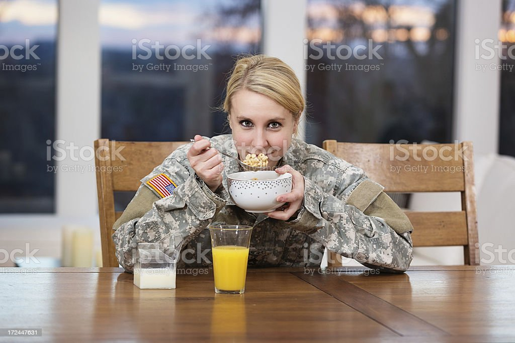 Woman in uniform eating breakfast at home royalty-free stock photo