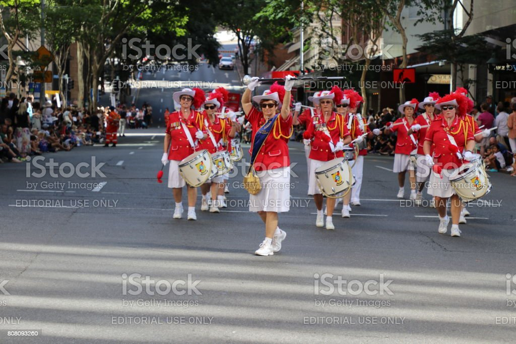 Woman in uniform marching stock photo