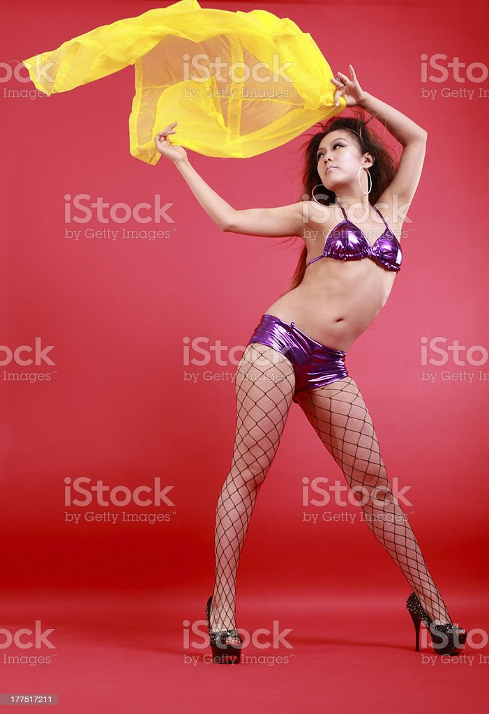 woman in various dance costumes and fun poses. royalty-free stock photo