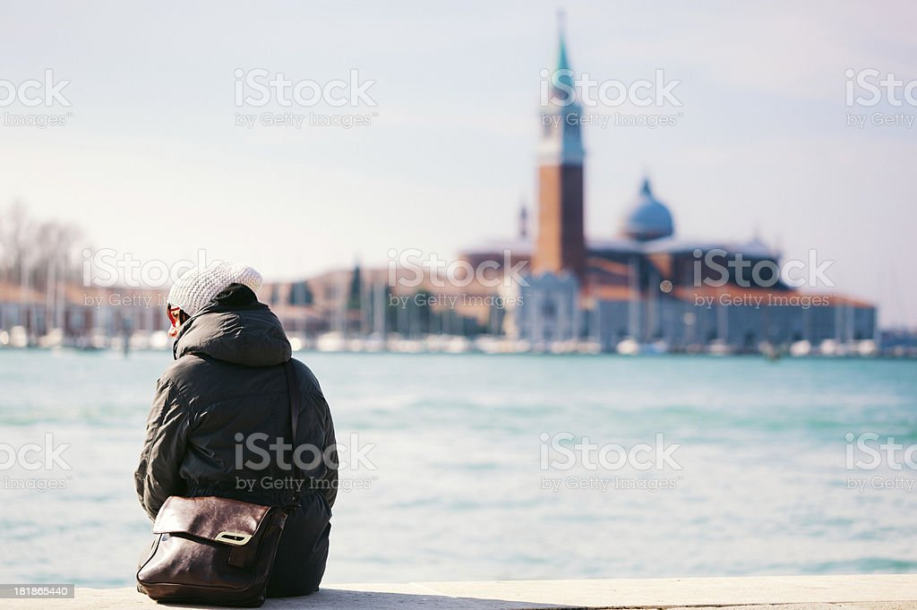 Woman in Venice during cold season royalty-free stock photo