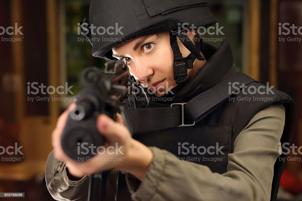 Woman in vest shot at the shooting stock photo