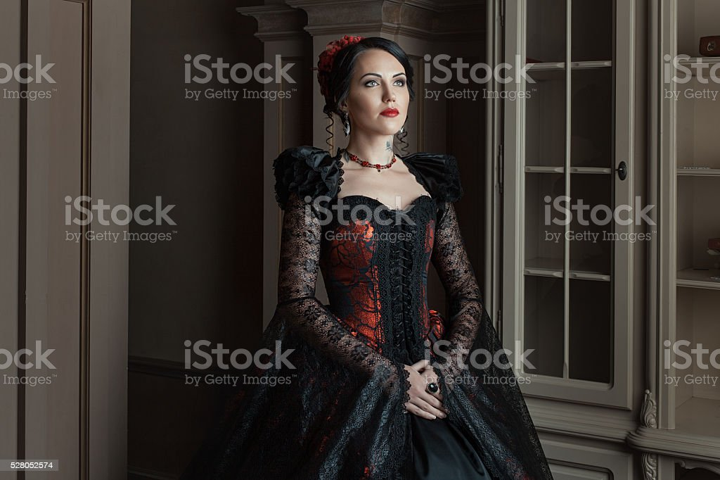 Woman in vintage dress old. stock photo