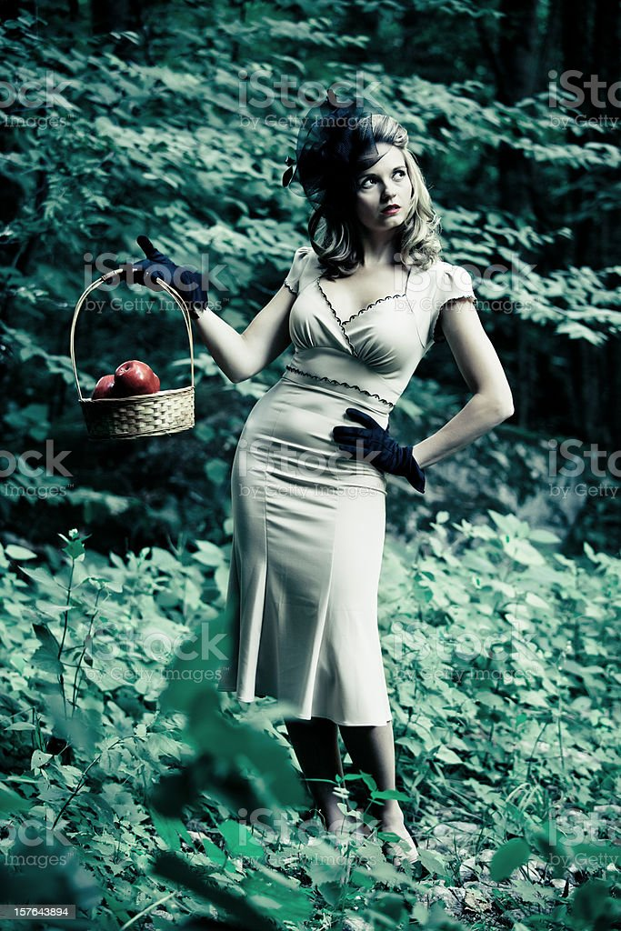 woman in vintage dress with an apple basket royalty-free stock photo