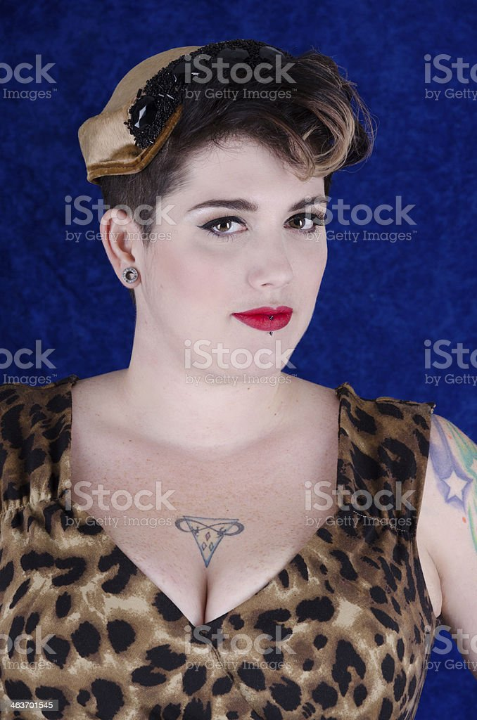 Woman in vintage hat and leopard print dress. royalty-free stock photo