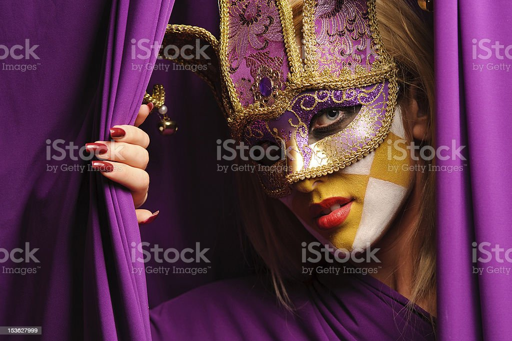 woman in violet carnival mask stock photo