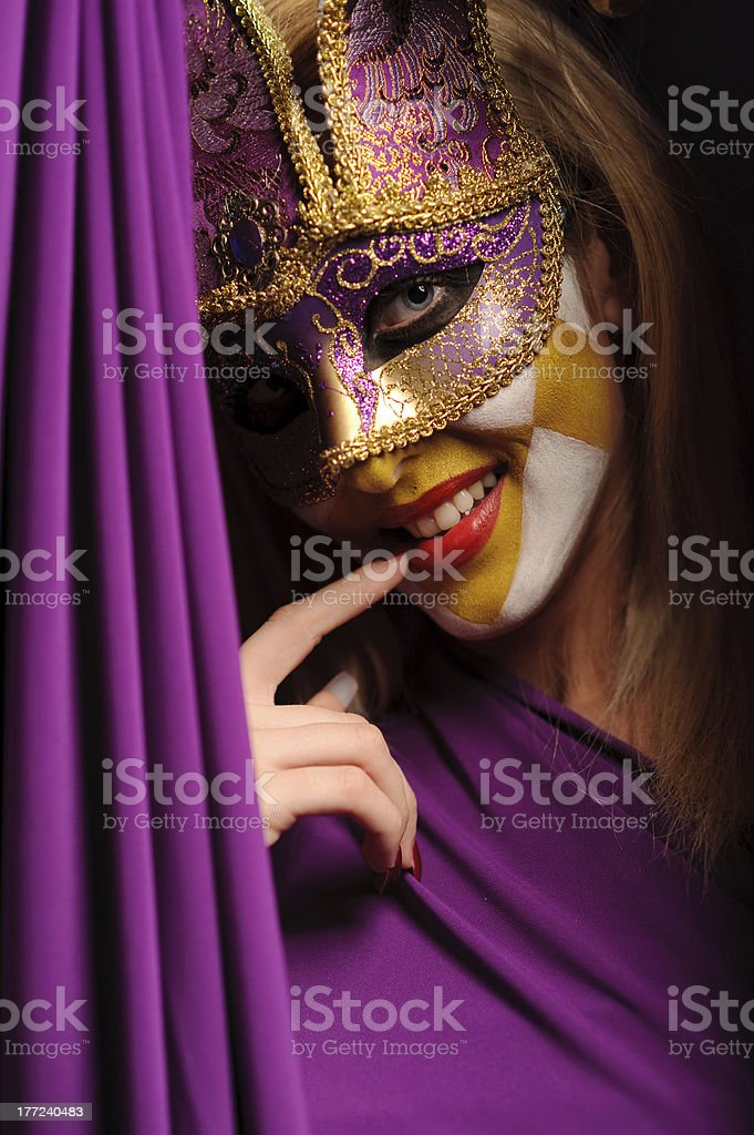 woman in violet carnival mask royalty-free stock photo