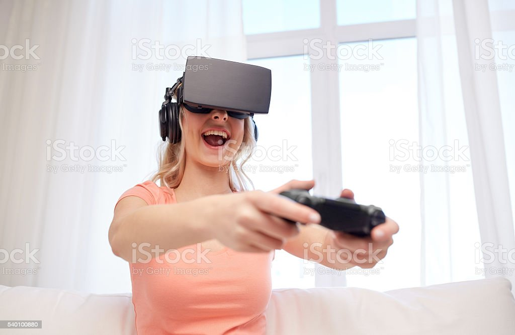 woman in virtual reality headset with controller stock photo