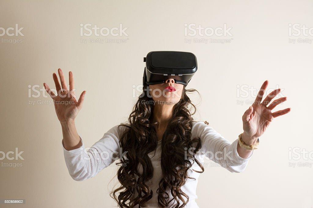 Woman in virtual reality helmet. VR glasses. stock photo