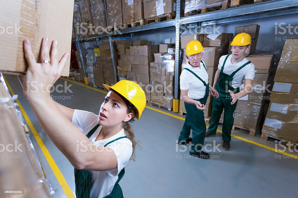 Woman in warehouse stock photo