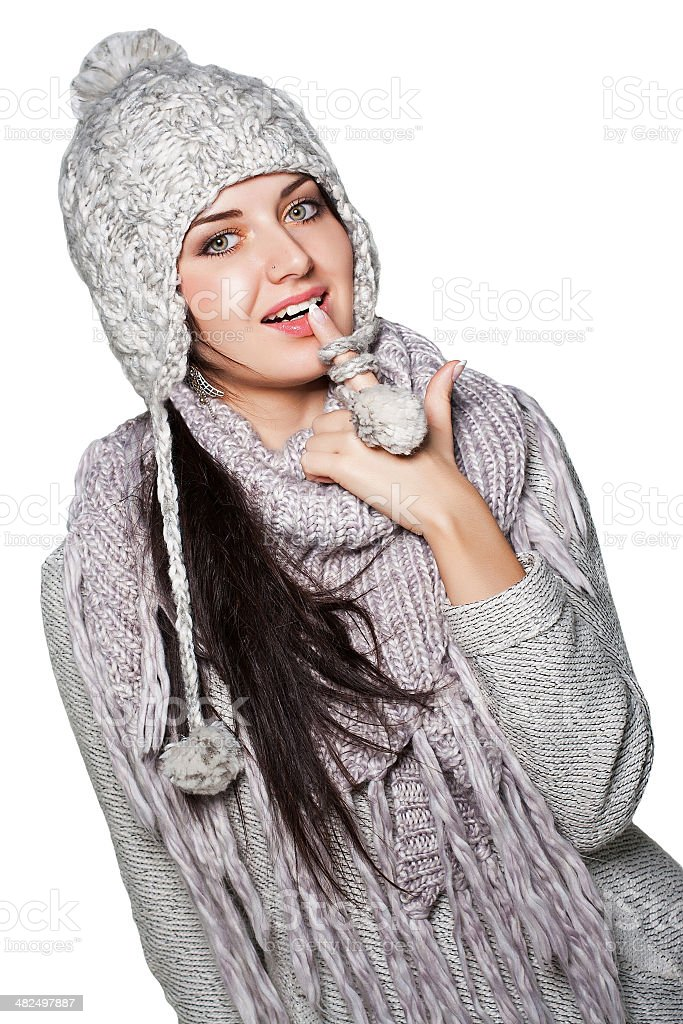 Woman in warm clothes indoors stock photo