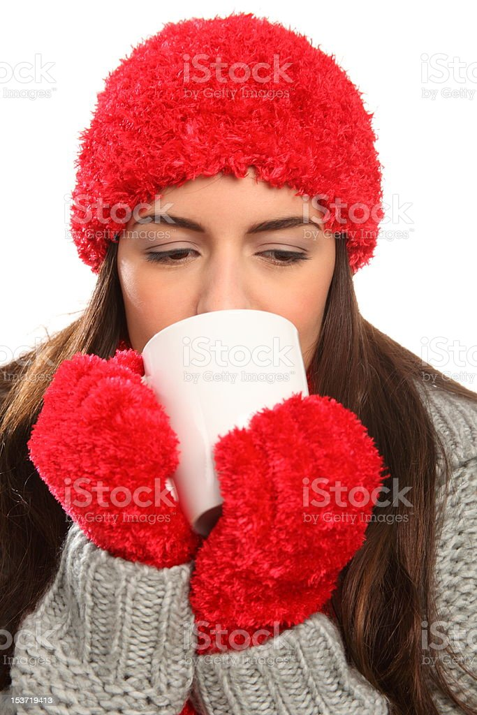 Woman in warm festive woolly hat with hot drink royalty-free stock photo
