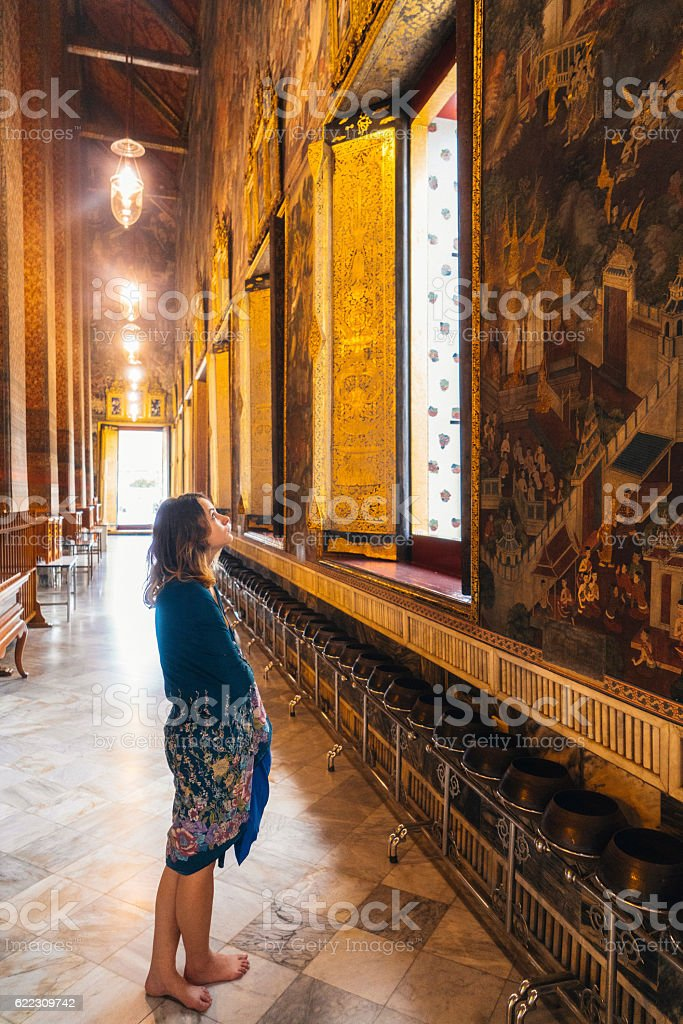 Woman in Wat Pho temple stock photo