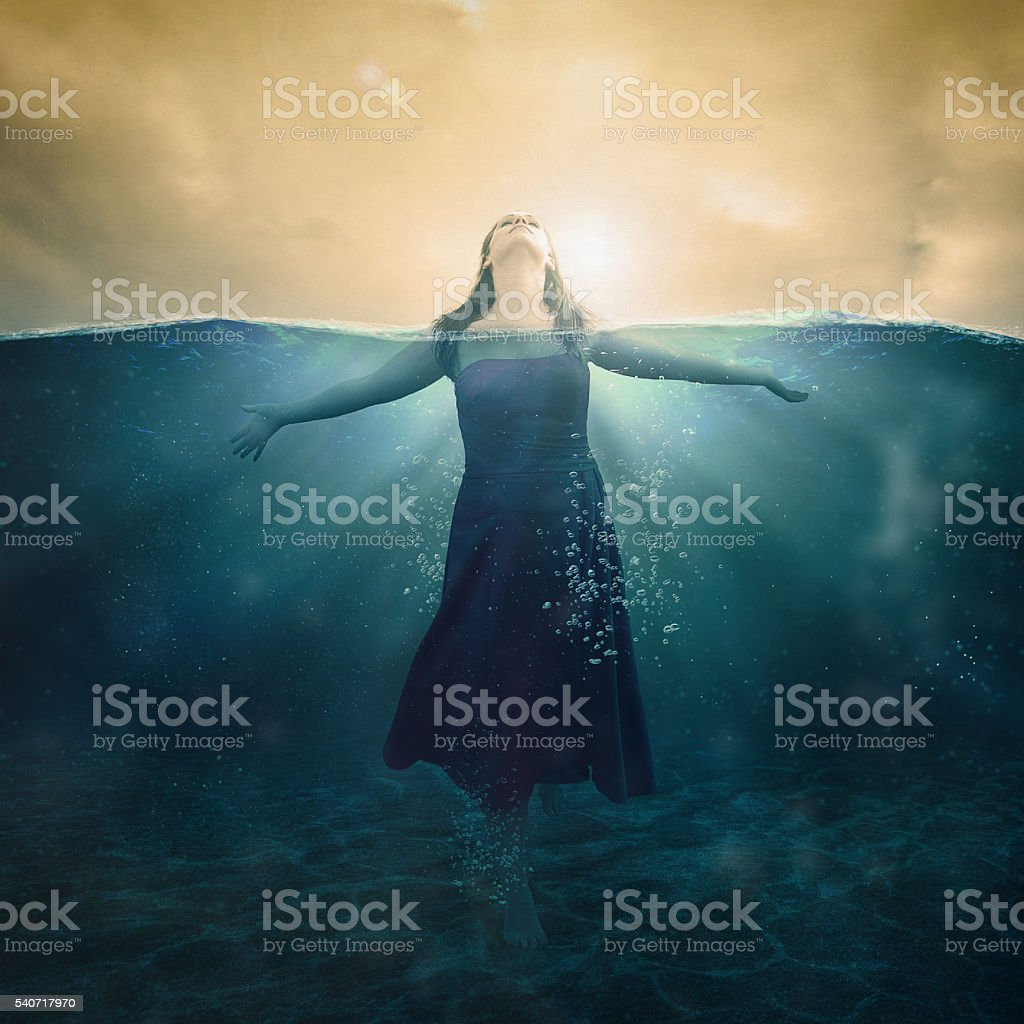 Woman in water stock photo