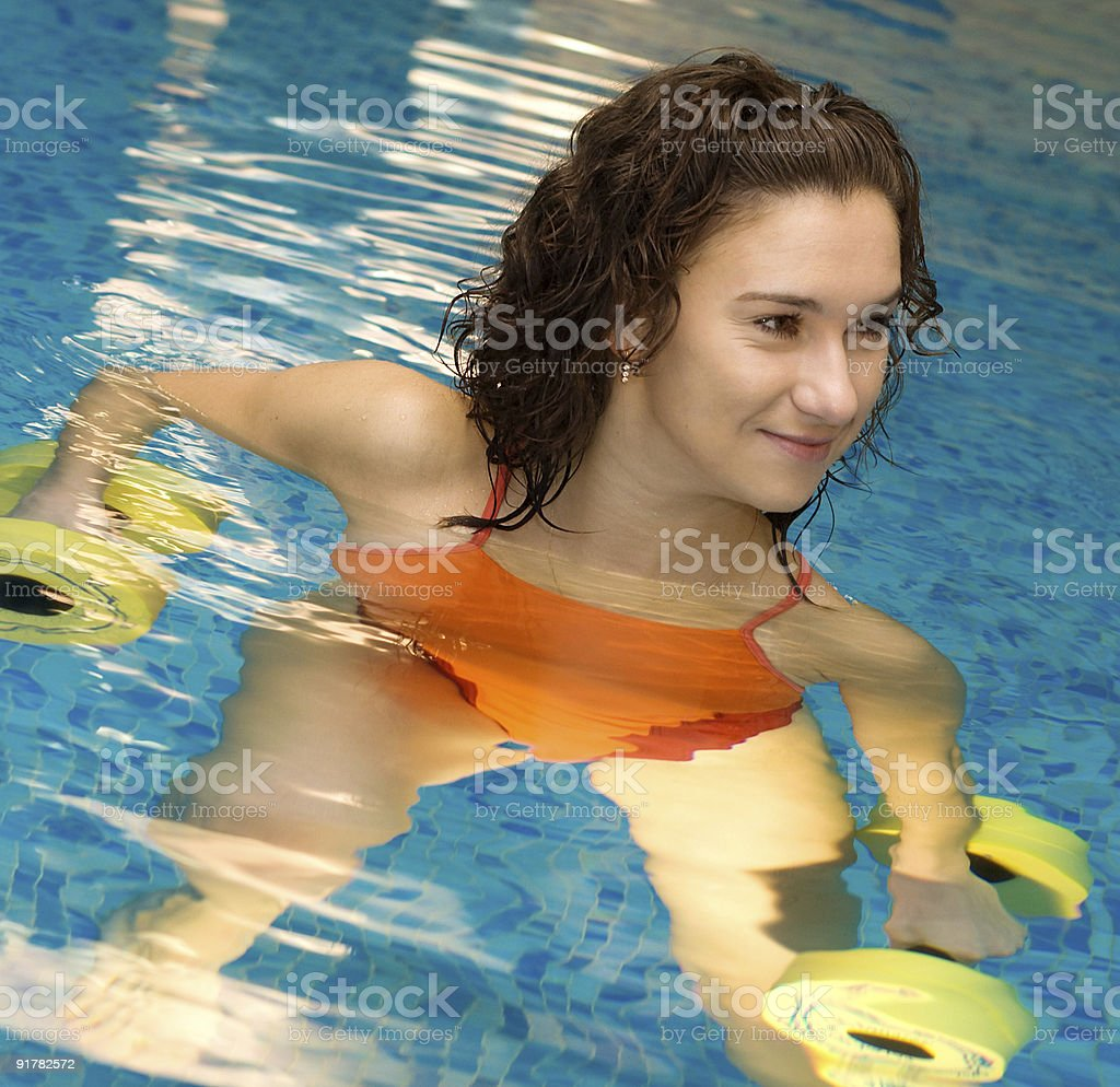 Woman in water with dumbbels royalty-free stock photo