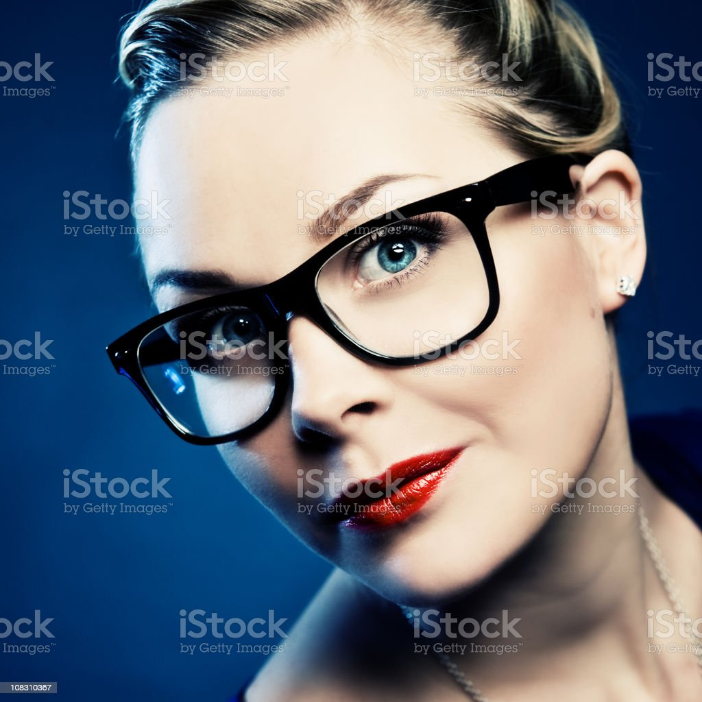Woman in wayfarer-glasses royalty-free stock photo