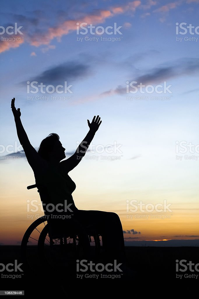 Woman In Wheelchair Embracing Life royalty-free stock photo