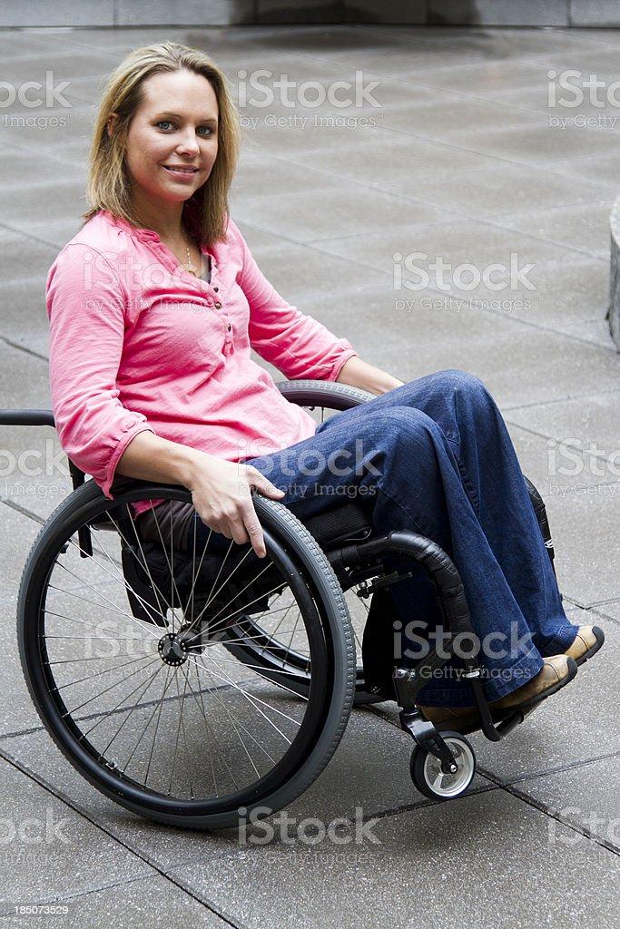 Woman in Wheelchair Rocking Back - Wheelie royalty-free stock photo