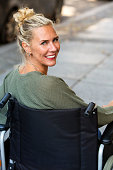woman in wheelchair smiling at camera