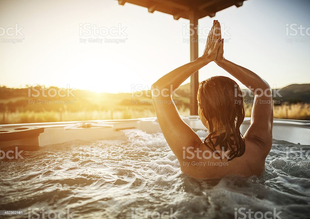 Woman in whirlpool jacuzzi royalty-free stock photo
