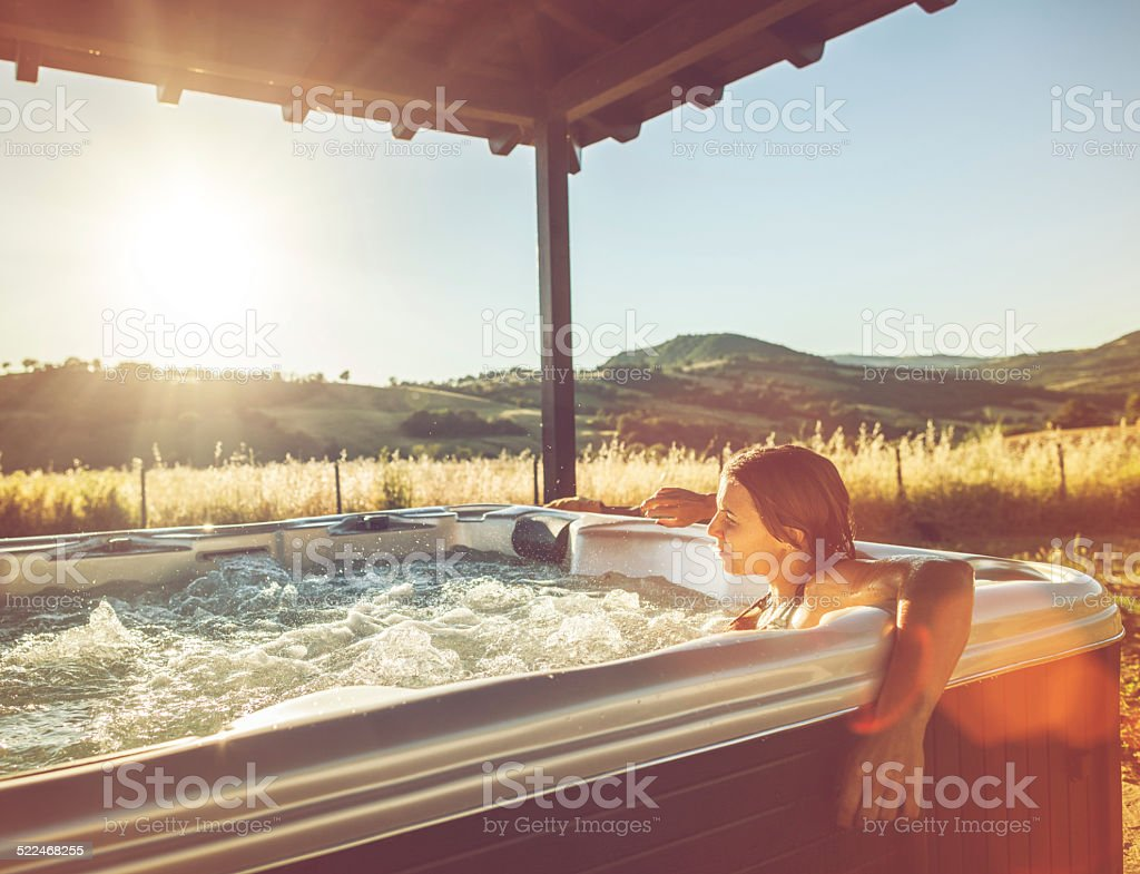 Woman in whirlpool jacuzzi stock photo