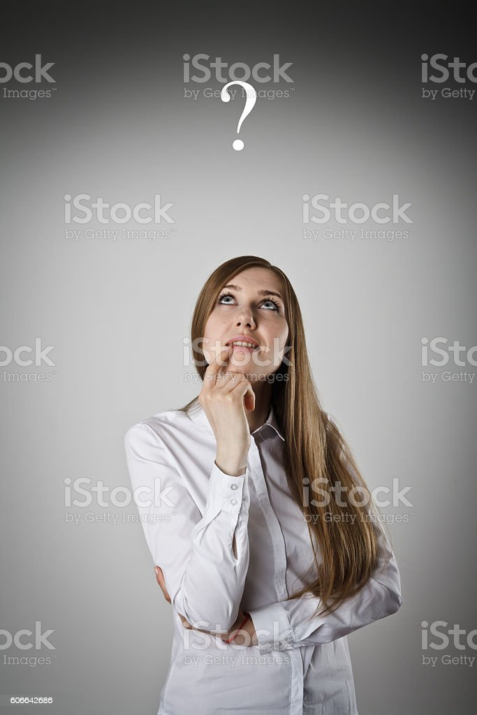 Woman in white and question mark stock photo