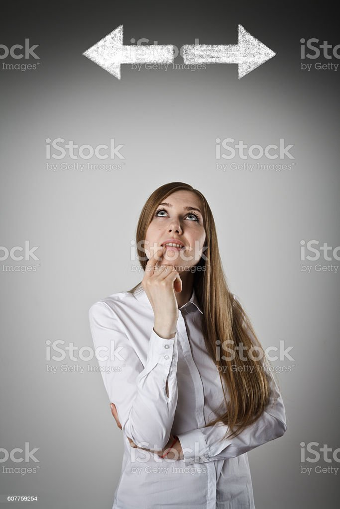 Woman in white and two arrows. stock photo