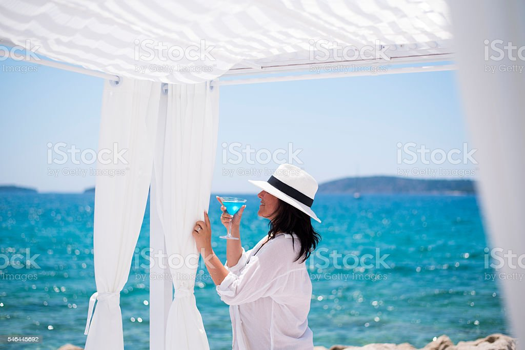 Woman in white by the sea stock photo