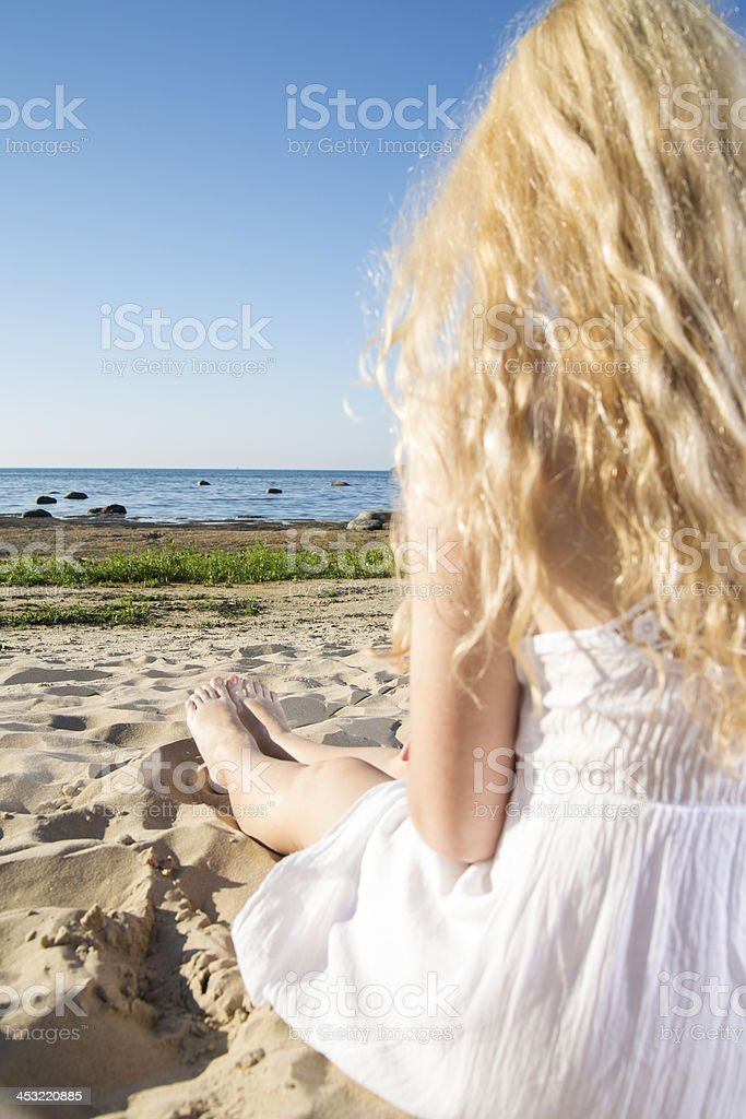 Woman in white dress stretches the legs royalty-free stock photo