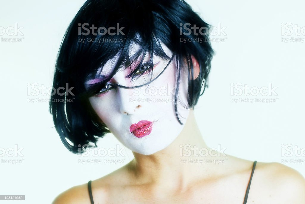 Woman in white face paint stock photo