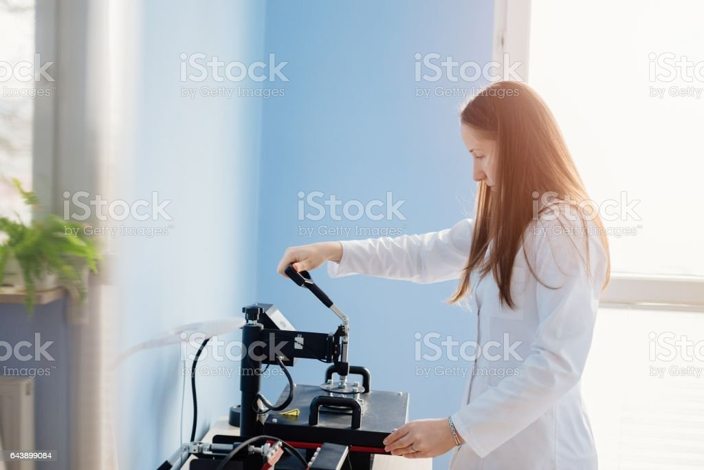 Woman in white lab thermal transferring image stock photo
