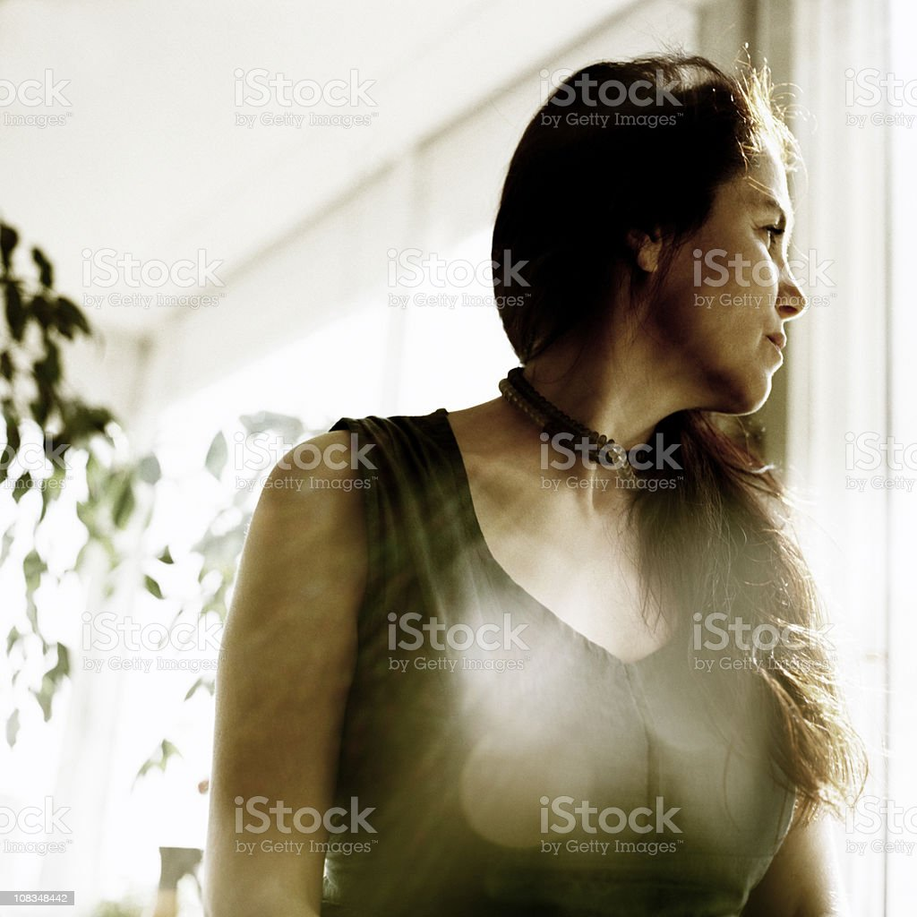 Woman in White Room stock photo