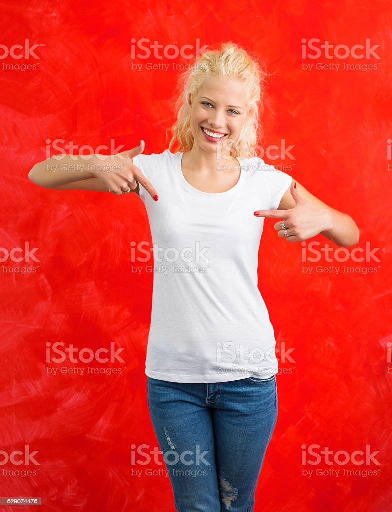 Woman in white round neck T-shirt on red background stock photo