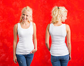 Woman in white tank top on red background