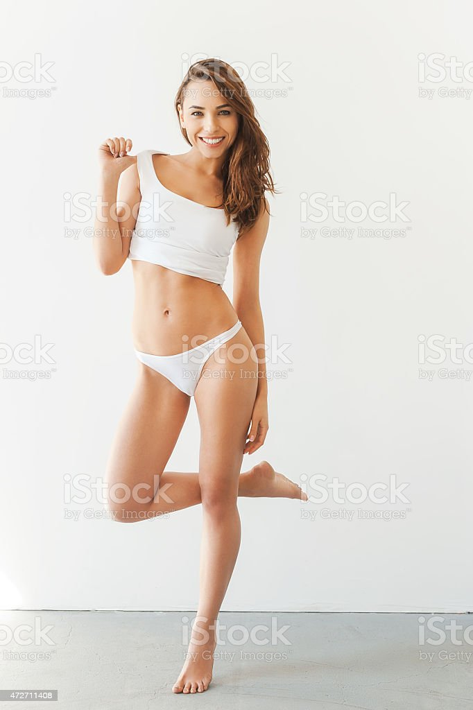Woman in white undergarments, posing stock photo