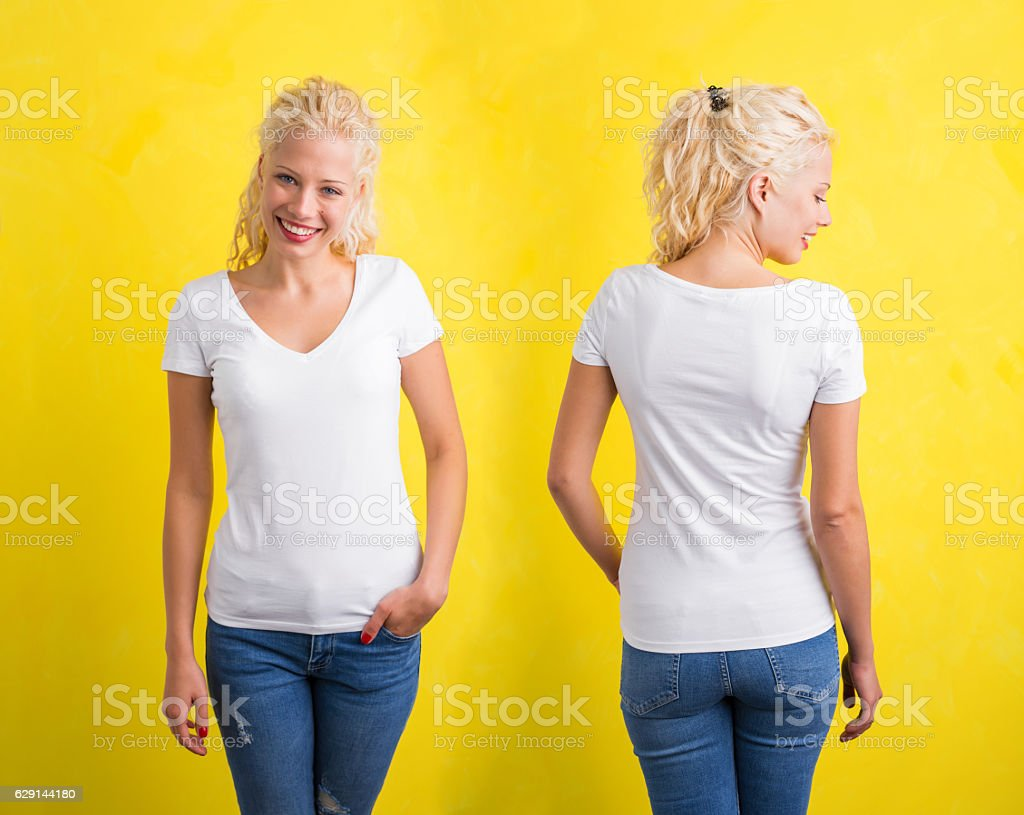 Woman in white V-neck T-shirt on yellow background stock photo