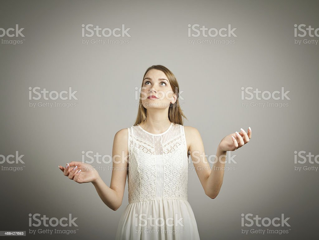 Woman in white with hands in juggling position stock photo