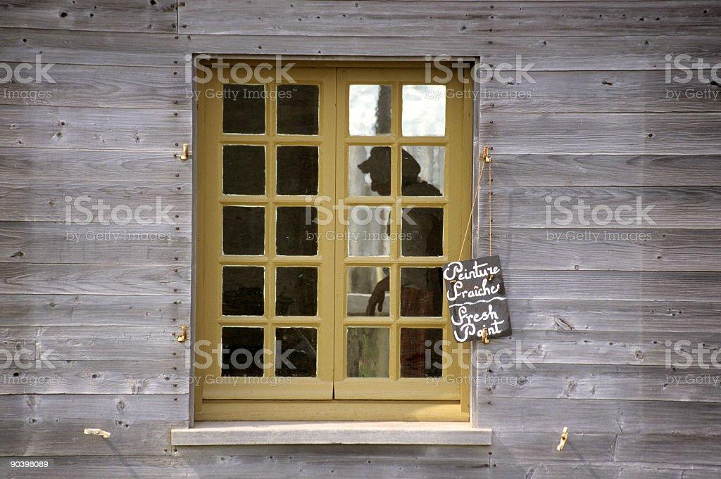 Woman in Window stock photo