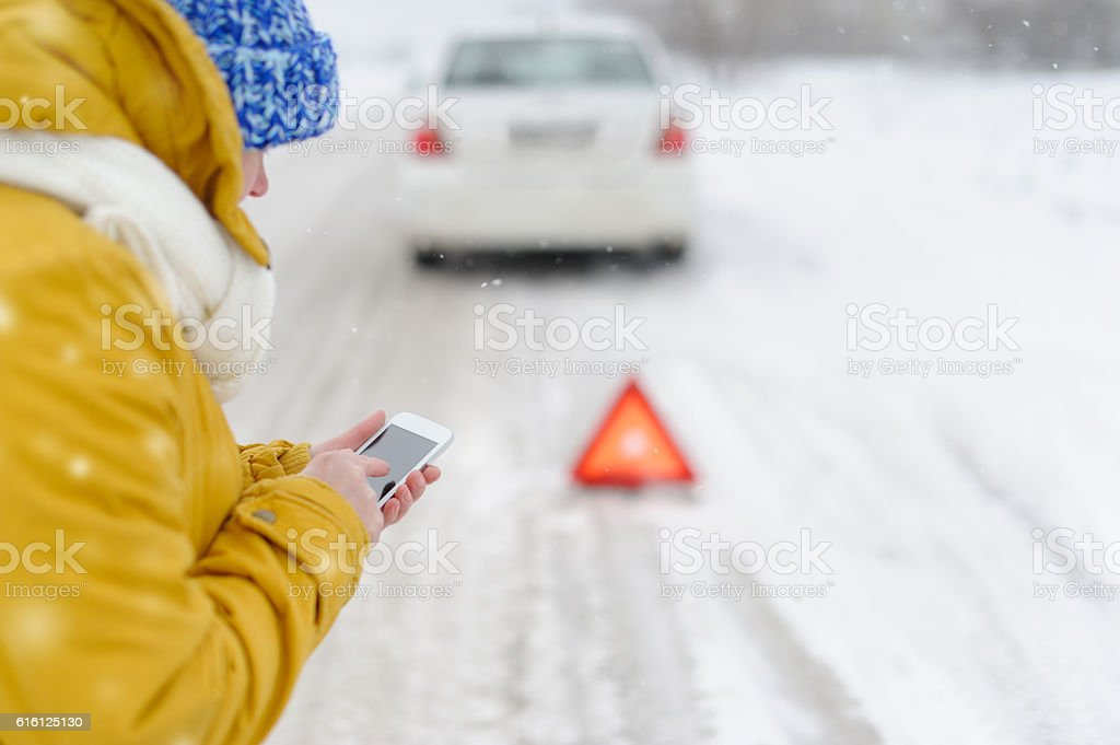 Woman in winter calls to the emergency services. stock photo