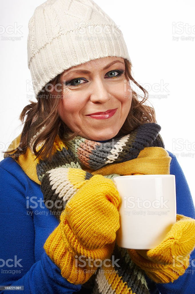 Woman in winter clothes with a cup of tea royalty-free stock photo