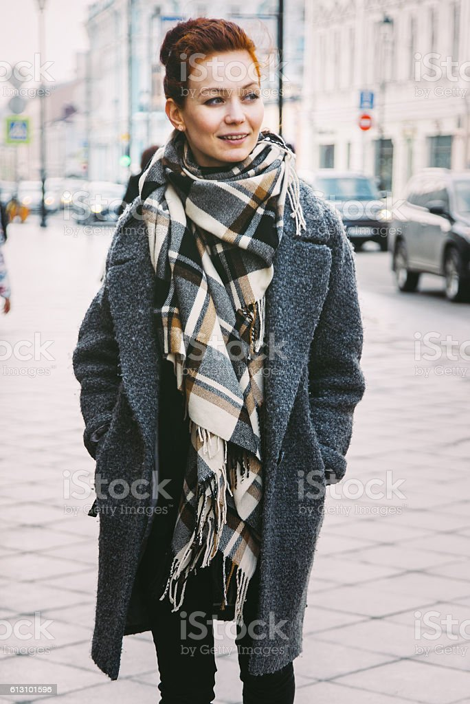 Woman in winter coat on the street stock photo