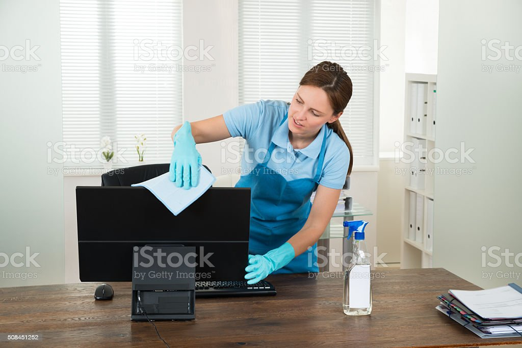 Woman In Workwear Rubbing Computer stock photo