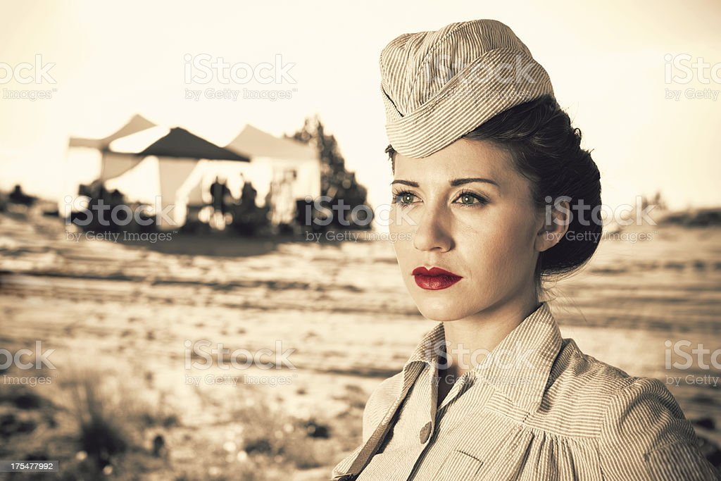 Woman in World War 2 military outfit stock photo