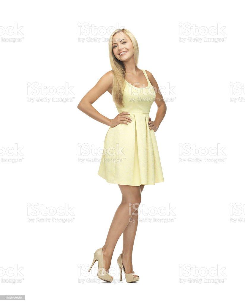 woman in yellow dress stock photo
