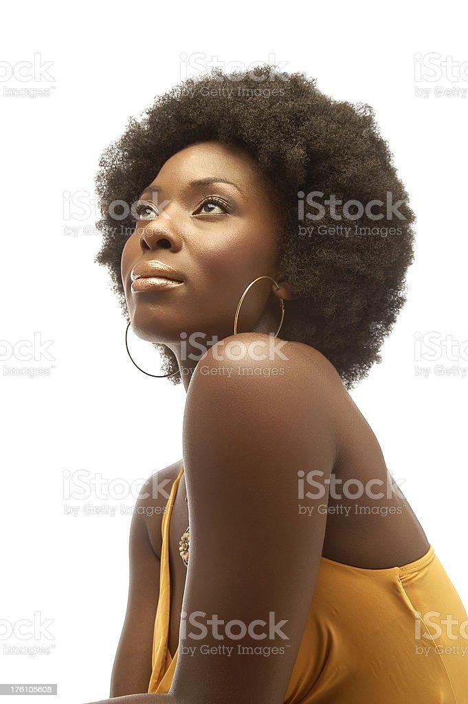 Woman in Yellow Top Gazing Upwards stock photo