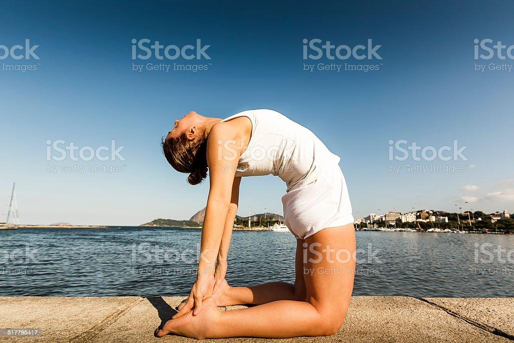 Woman in Yoga Camel Posture Ustrasana stock photo
