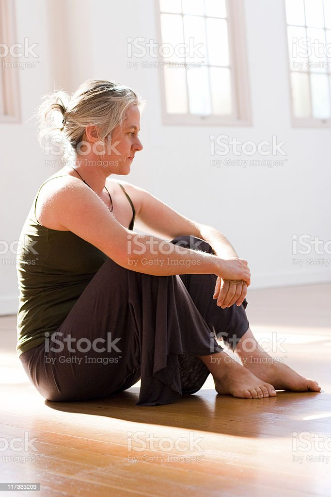Woman in Yoga Clothing royalty-free stock photo